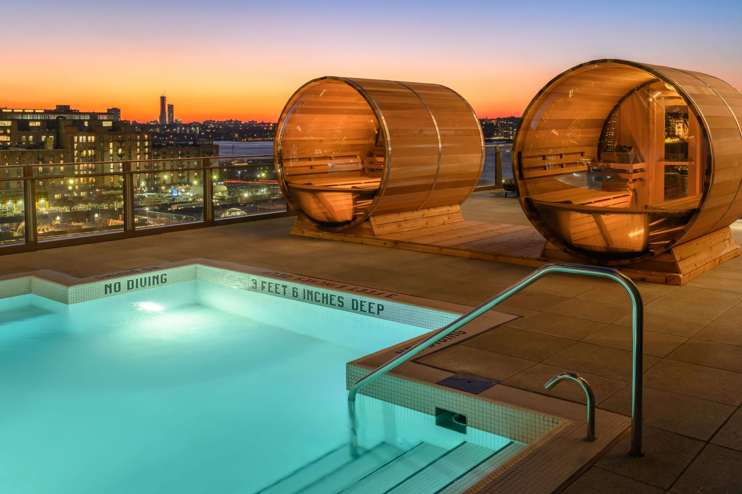rooftop pool with barrel saunas