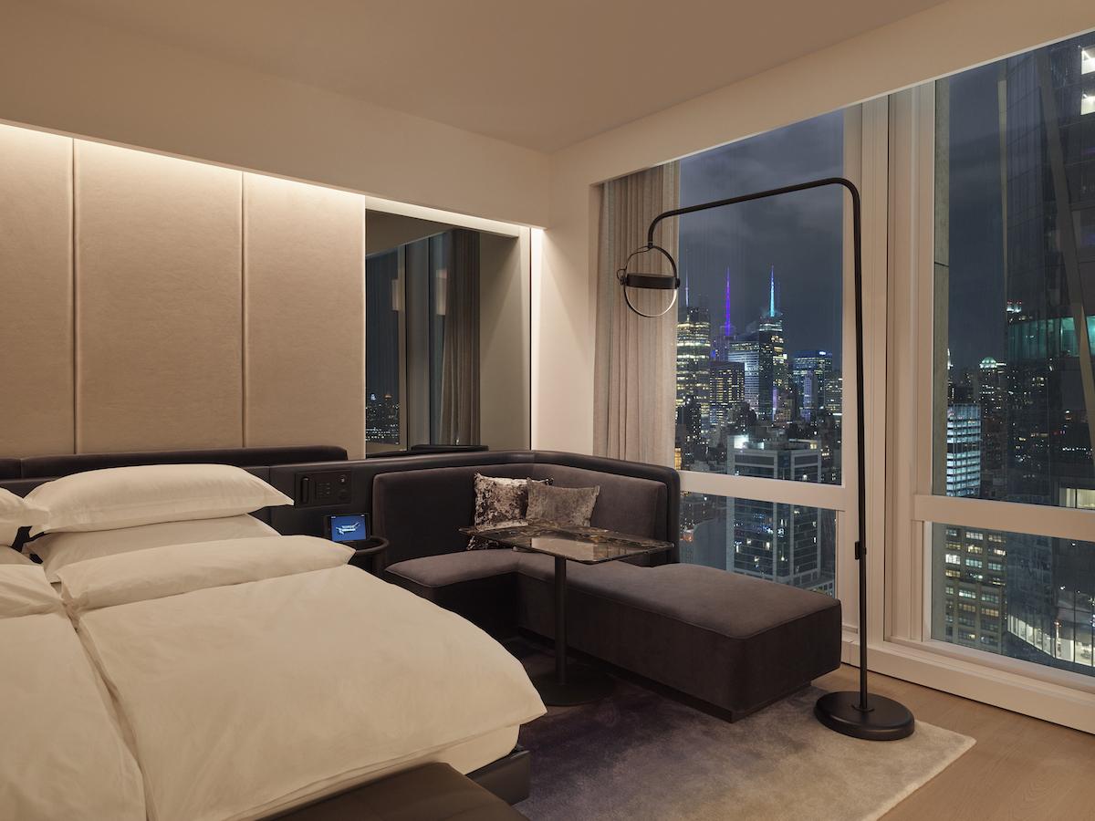 equinox hotel room city view at night