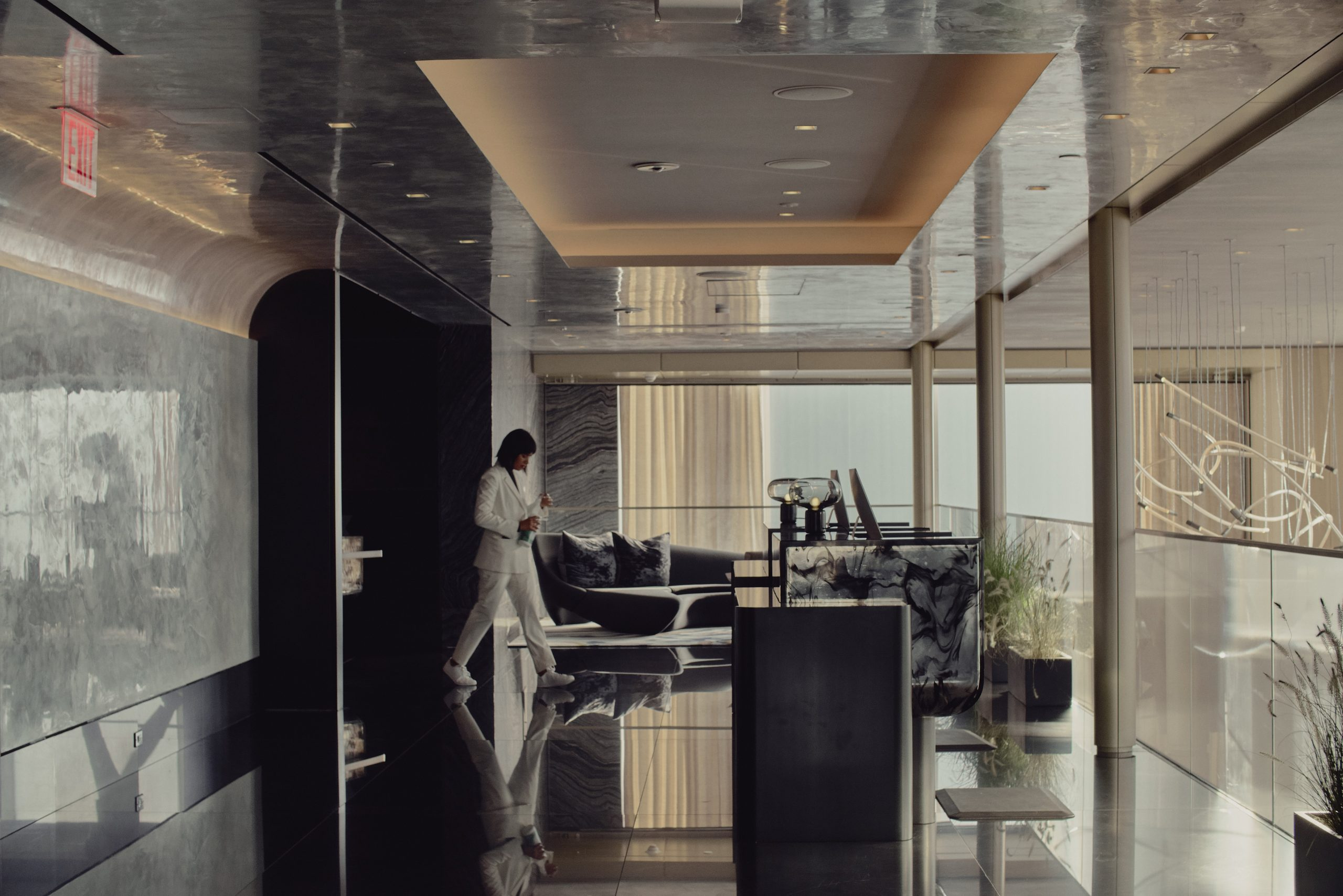 front desk associate crossing sky lobby