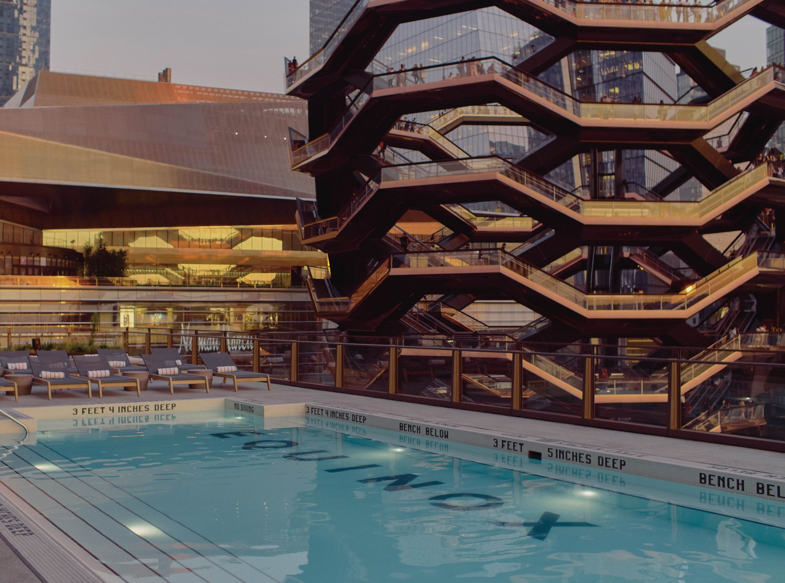 outdoor pool and sundeck looking out to vessel