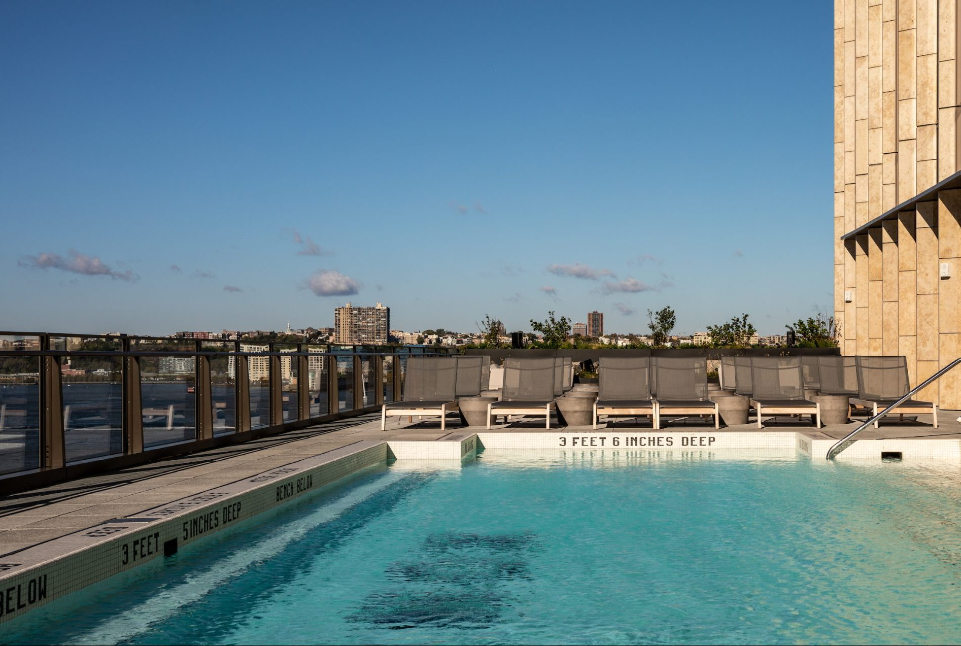 outdoor pool and sundeck overlooking hudson river