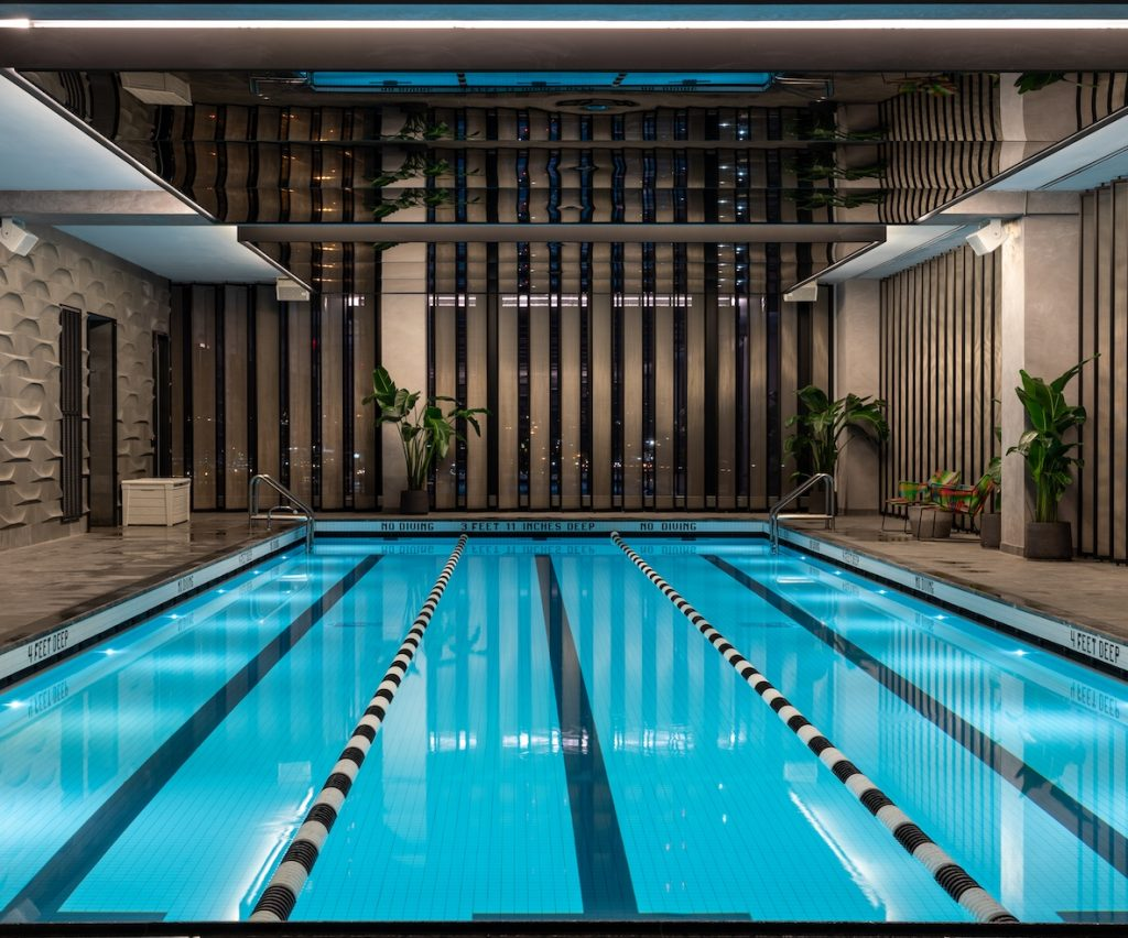 indoor lap swimming pool with reflective ceiling