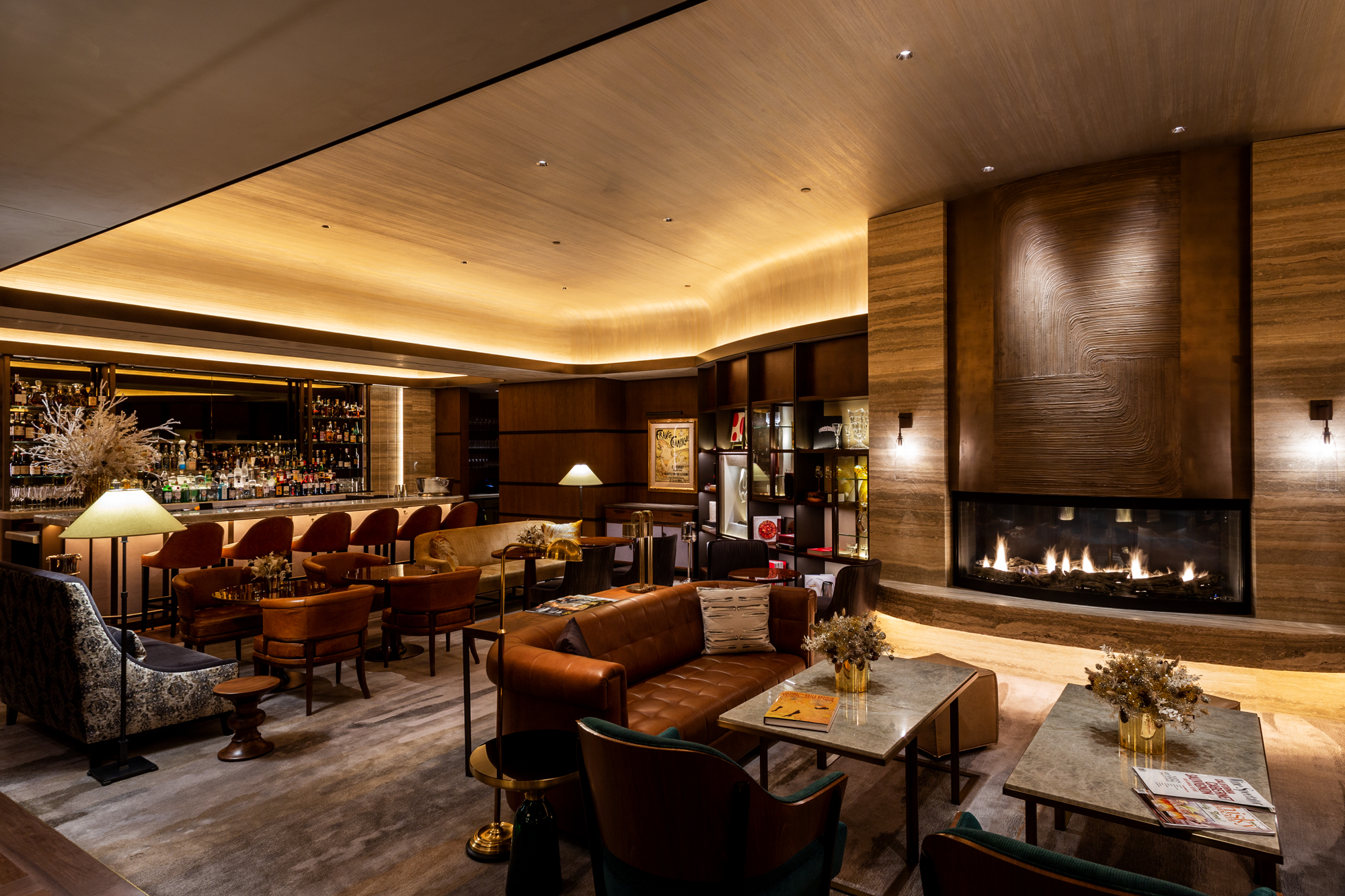 <seating, fireplace and bar at private club area of WS New York
