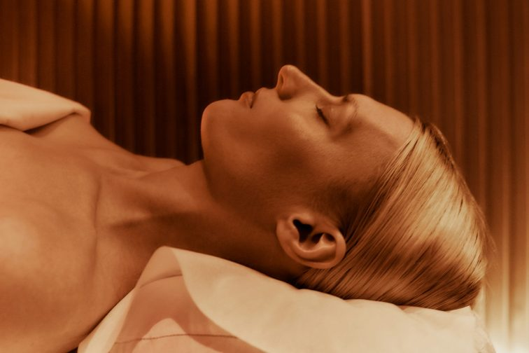 closeup image of woman's face receiving spa treatment in spa treatment room