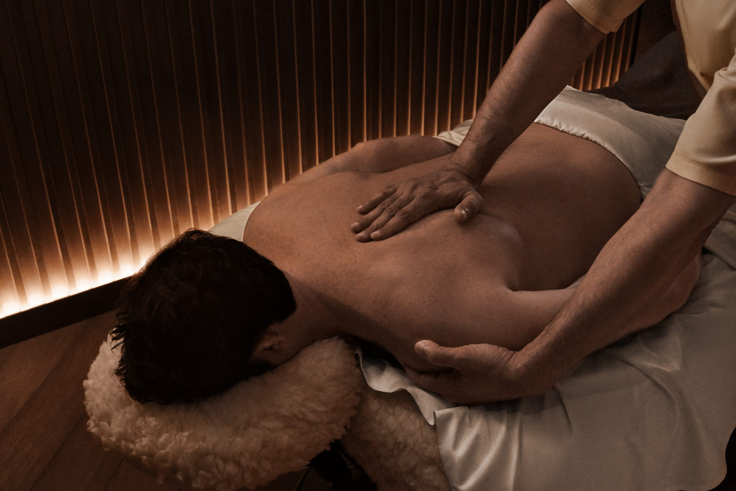 man receiving massage treatment in spa treatment room