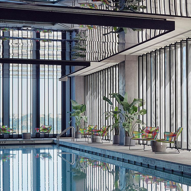 <equinox fitness club indoor pool with reflective ceiling and seating areas around pool