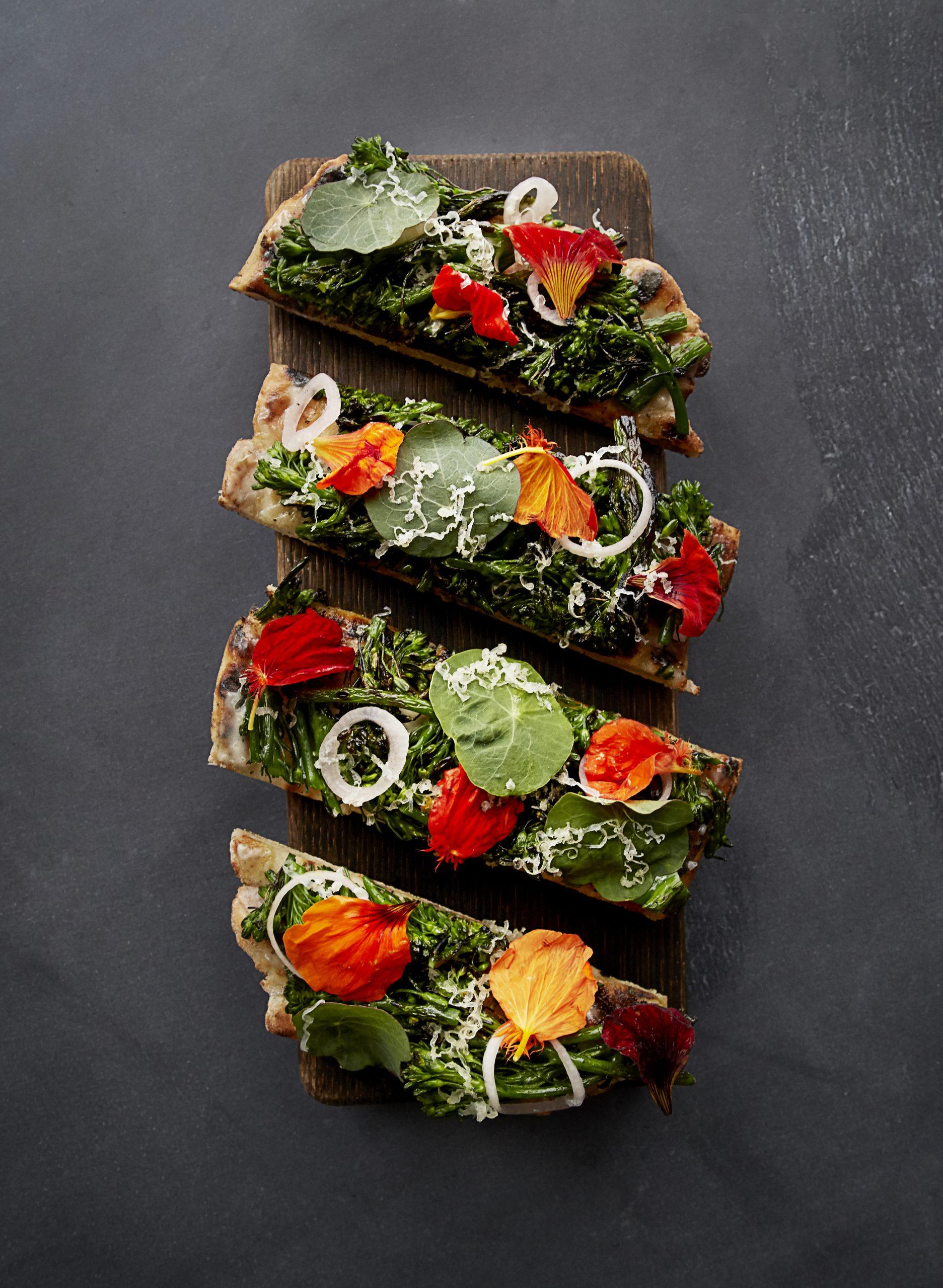 <broccoli rabe flatbread on wooden board