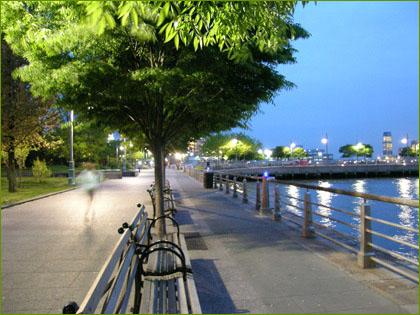 person running along hudson river greenway