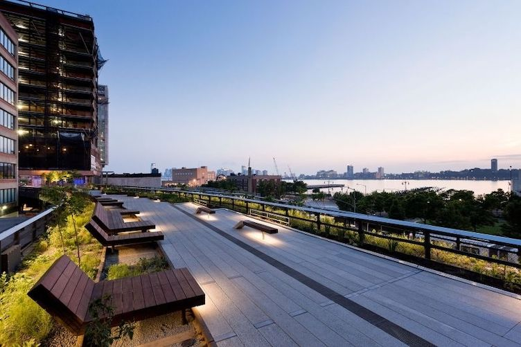the highline nyc lounge seating with trees and garden plantings and view to hudson river