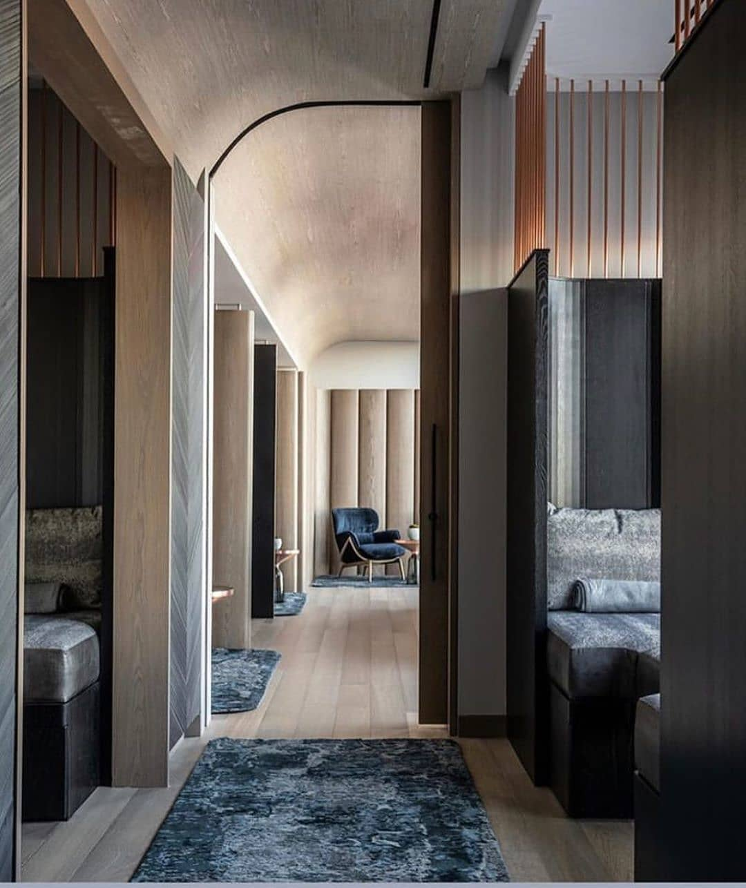 view down hallway at the spa by equinox hotels with view of private e.scape pods and to spa waiting room