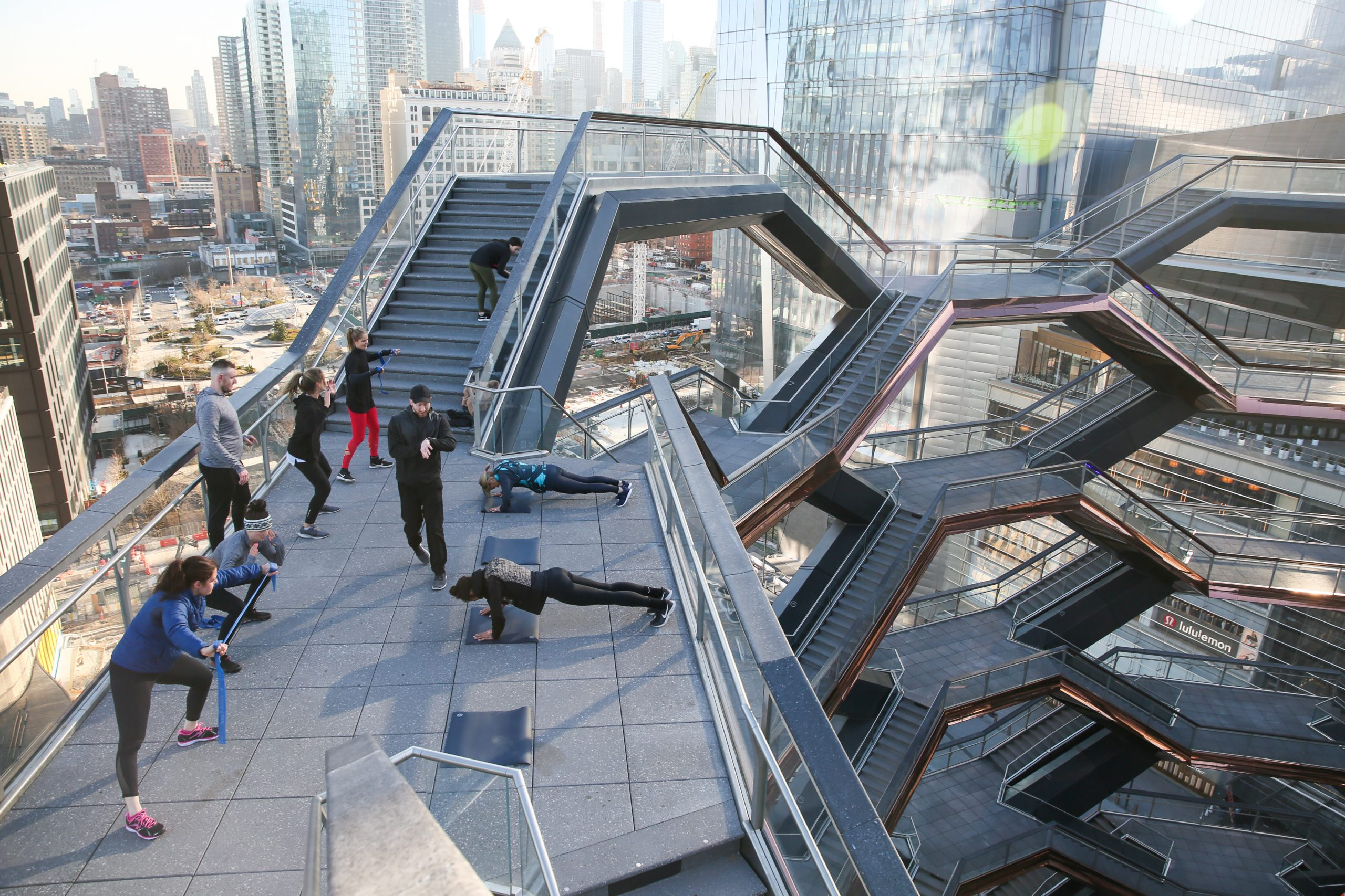 <group fitness class on vessel sculpture in hudson yards