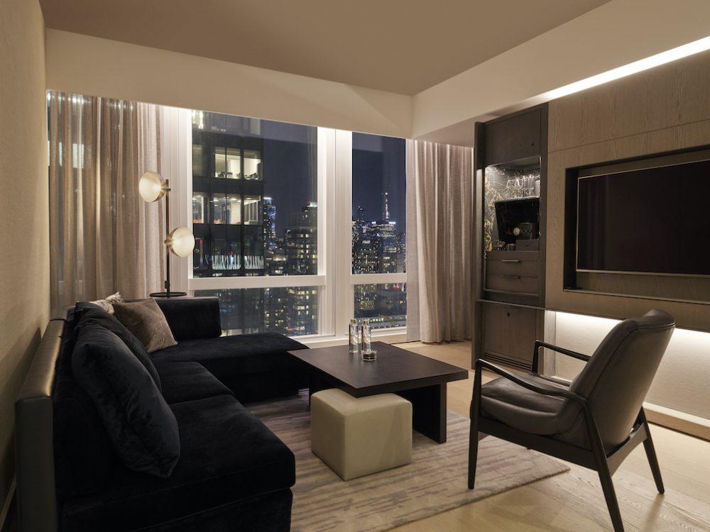 <deluxe one bedroom suite bedroom