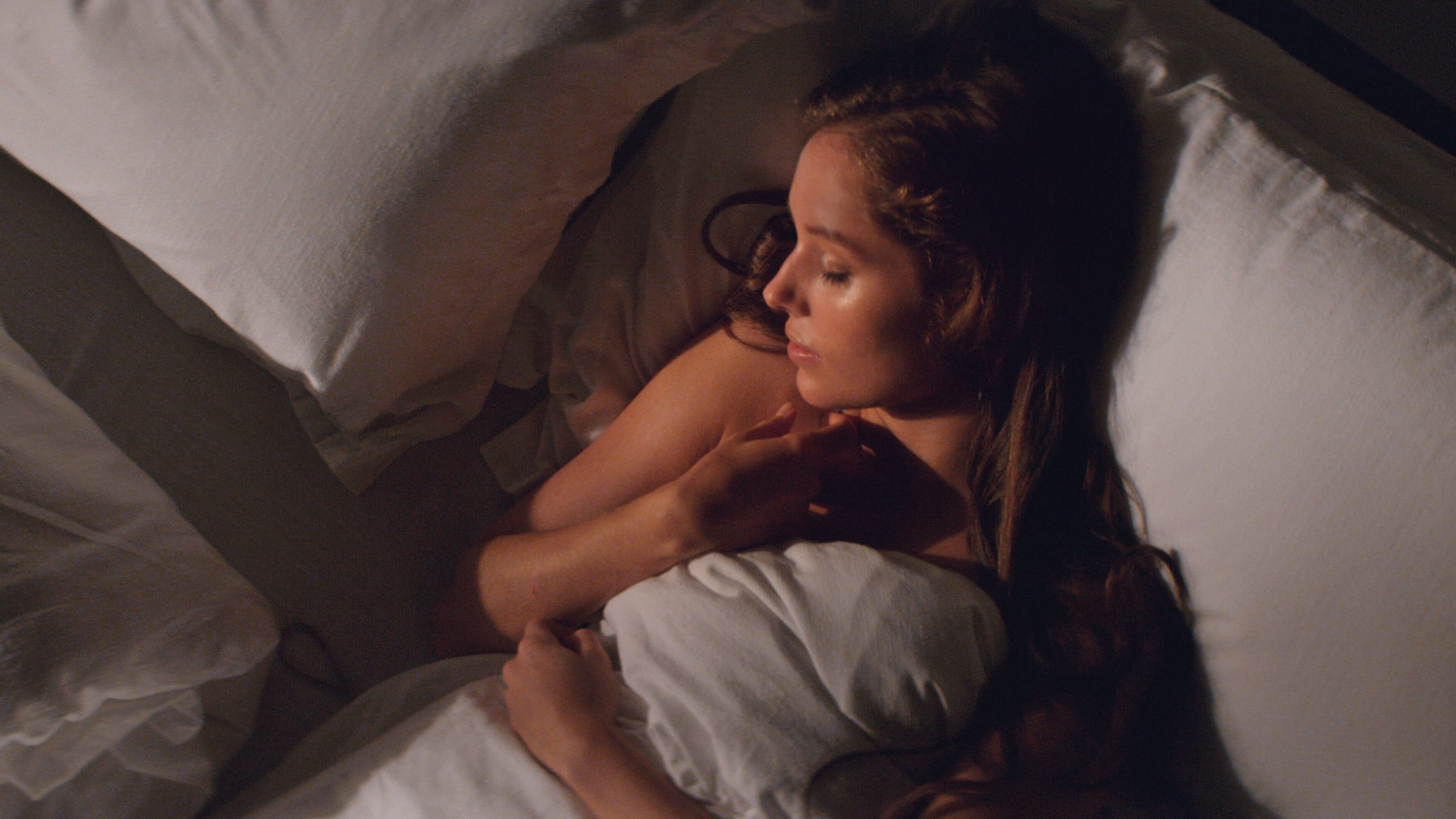 woman laying in equinox bed