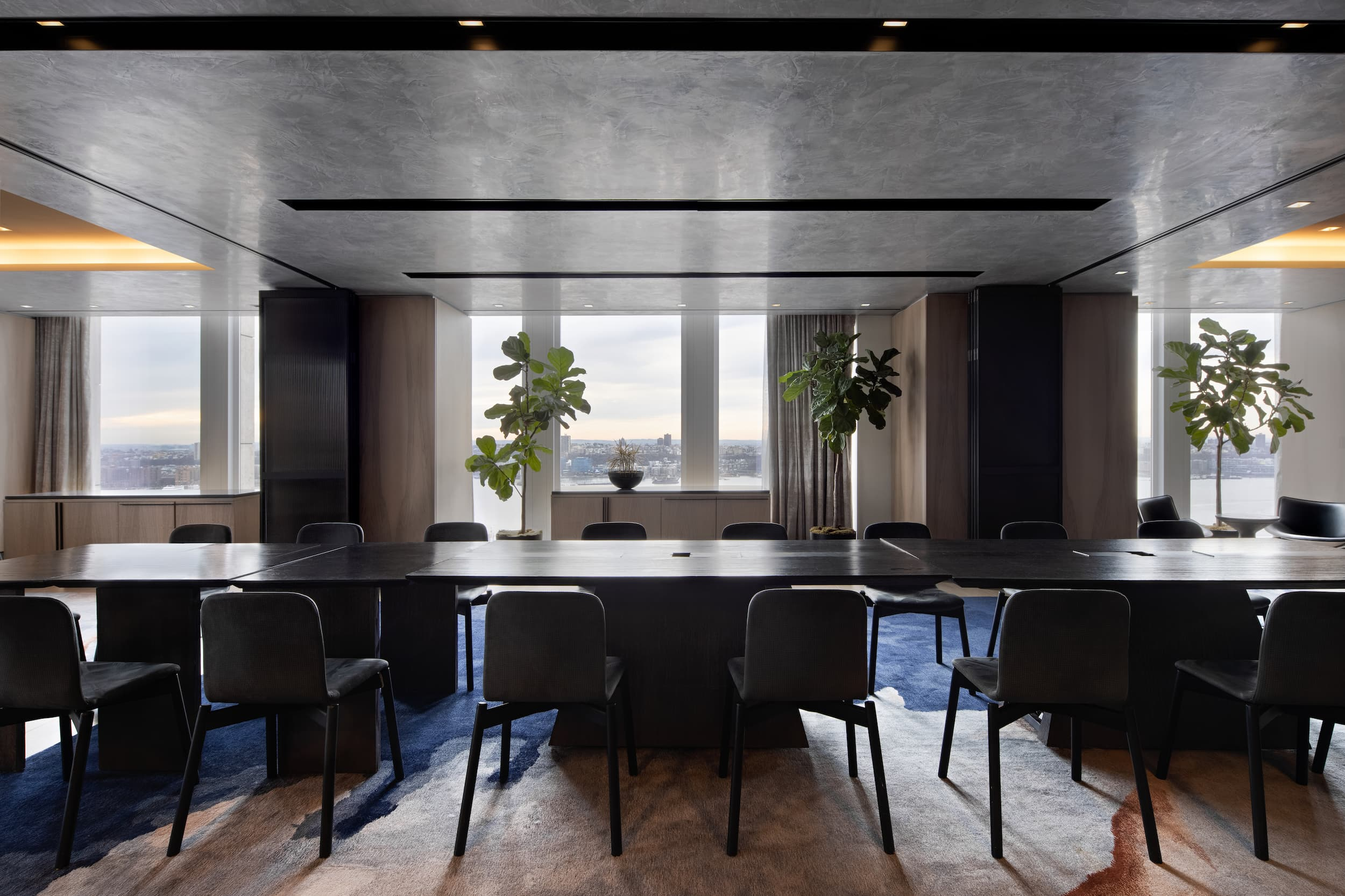 <private dining room with meeting table setup and views to river