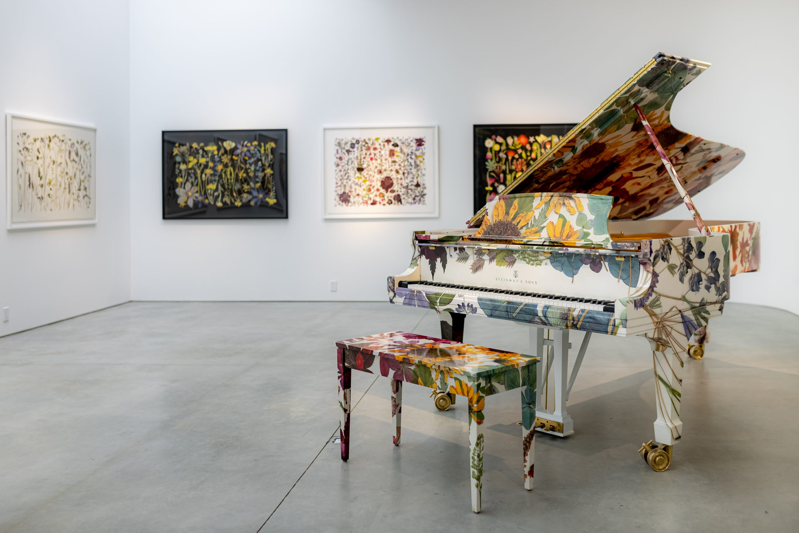 <piano decorated with florals in art gallery at high line nine galleries