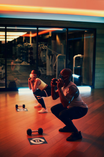 couple working out in fitness center studio