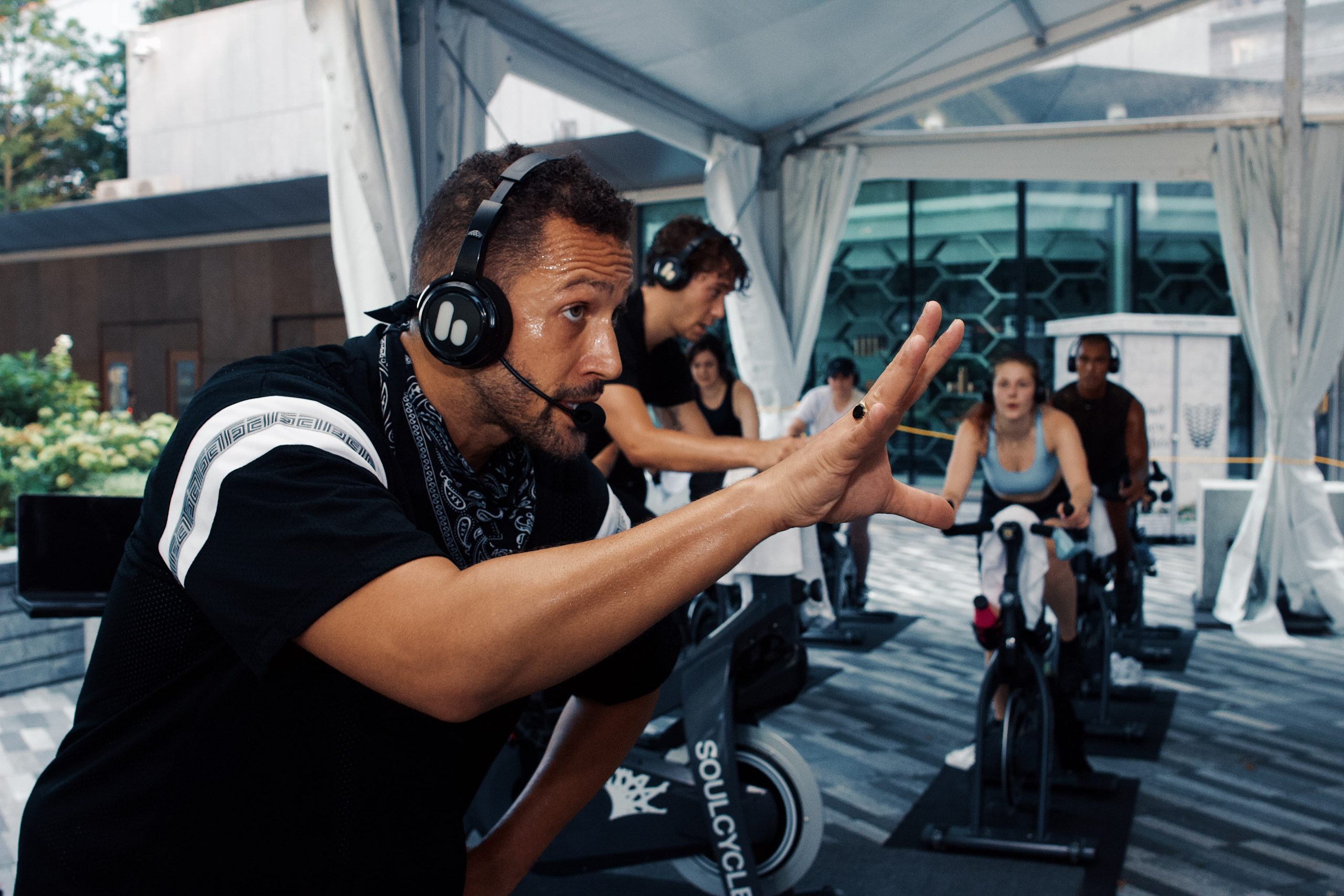 <soulcycle instructor in tented class