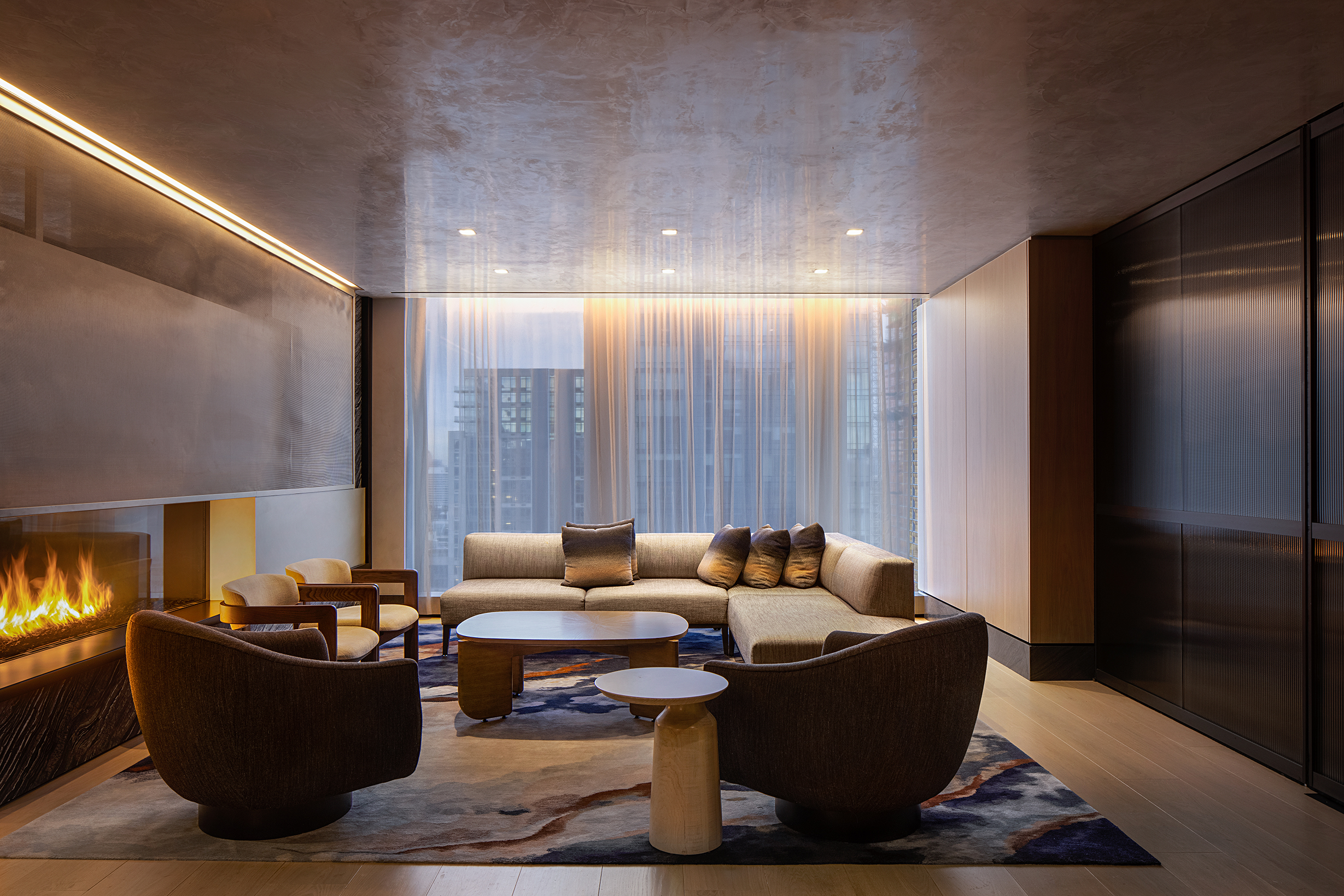 <Private lounge area with fireplace
