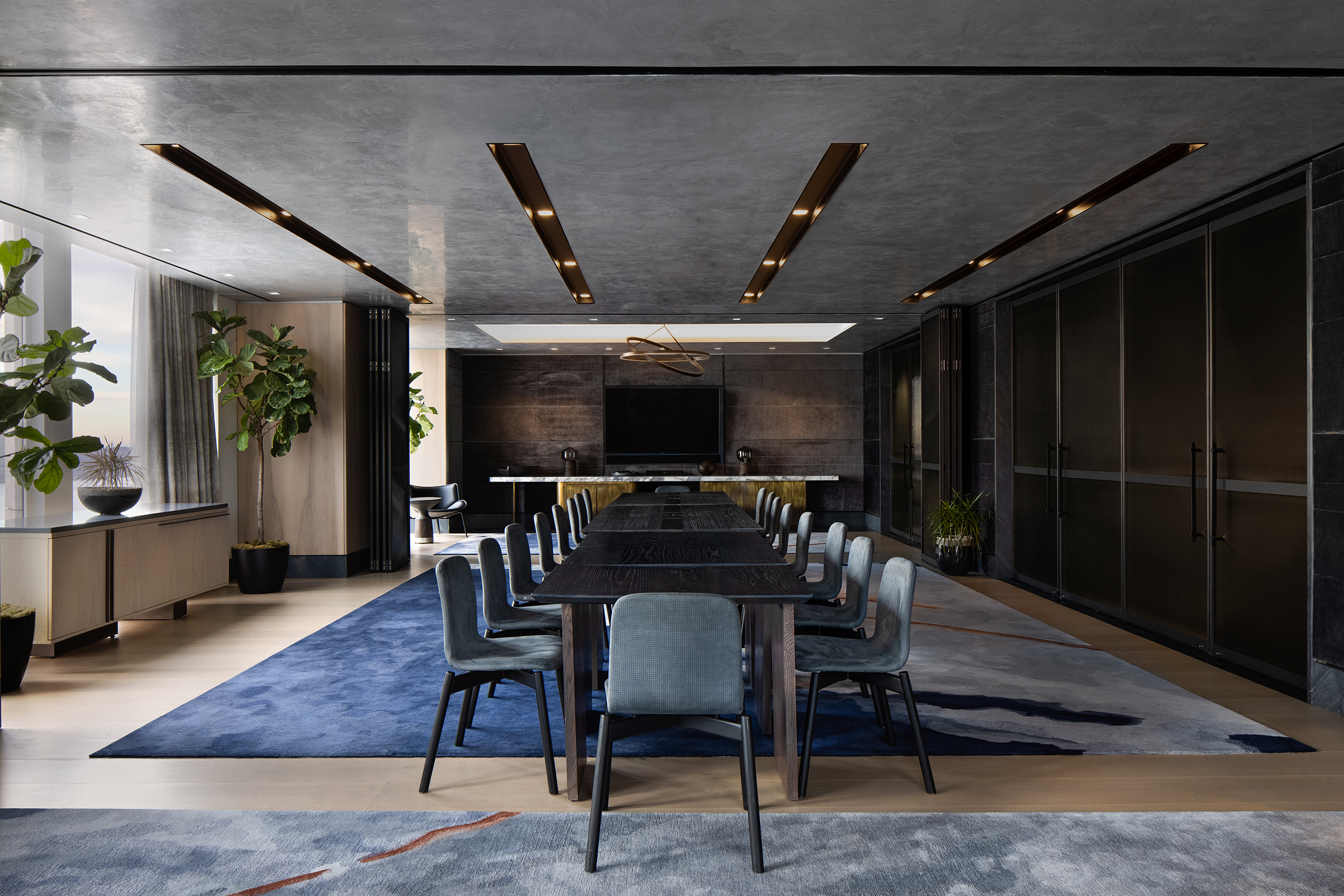 <private dining room table facing a screen